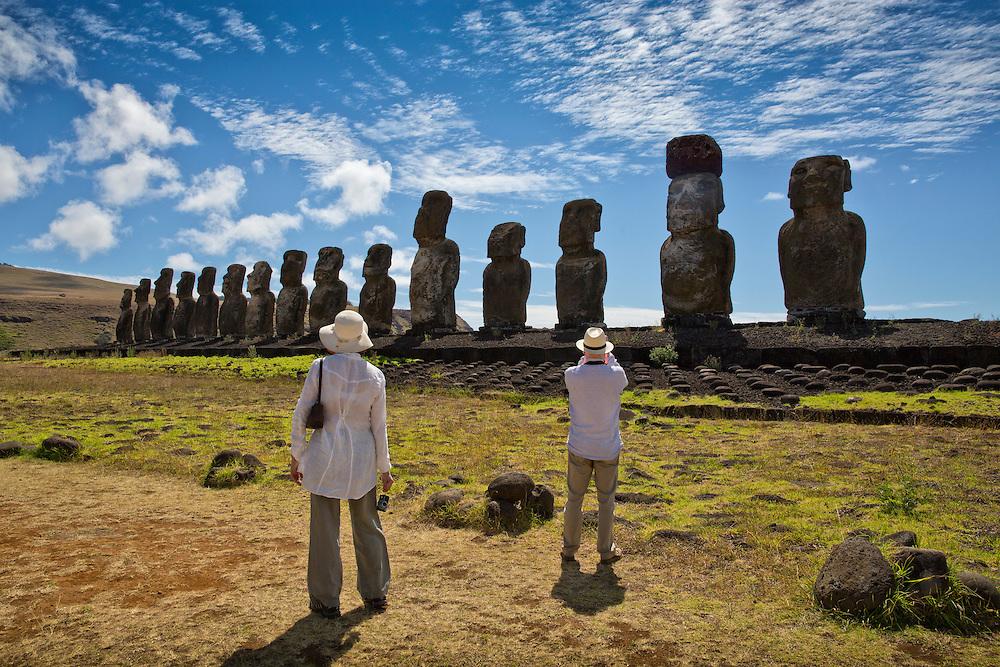 Tourists take in the Moai statues at Tongariki on Easter Island.