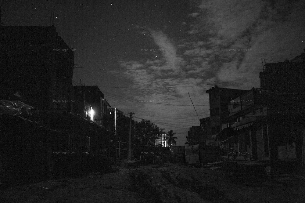 3am at Kusheshwar Asthan east, on the Kosi river flood plains. The town has no electricity connection and the only light comes from a random generator. In the rainy season the roads become a knee deep mud that prevents any vehicles from coming any closer than 6km away.
