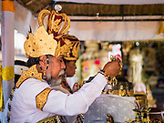19 JULY 2016 - TAMPAKSIRING, GIANYAR, BALI, INDONESIA:  A Brahmin Hindu high priest leads a prayer on the first day of a ceremony to honor the anniversary Pura Agung temple, one of the most important Hindu temples on Bali. This year's ceremony is the most important in years because it falls on the 50 year cycle of the temple's founding. This year's ceremony lasts for 11 days.     PHOTO BY JACK KURTZ
