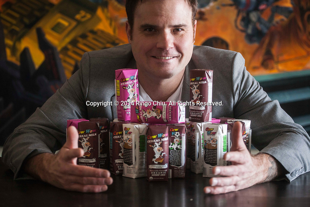 Chris Pouy of Cow Wow Cereal Milk company, makes cereal-flavored milk.<br /> (Photo by Ringo Chiu/PHOTOFORMULA.com)
