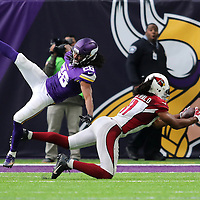 MINNEAPOLIS, MN - NOVEMBER 20:  Larry Fitzgerald of the Arizona Cardinals pulls in a pass while Trae Waynes of the Minnesota Vikings applies pressure in the second quarter on November 20, 2016 at US Bank Stadium in Minneapolis, Minnesota. (Photo by Adam Bettcher/Getty Images)