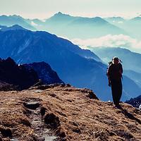 A trekker crosses a pass between Hinku and Khumbu valleys in the Khumbu region of Nepal. 1980.