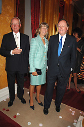Left to right, GERALD & AMANDA WARD and ANDREW PARKER -BOWLES at a party to celebrate the launch of the 'Inde Mysterieuse' jewellery collection held at Lancaster House, London SW1 on 19th September 2007.<br />