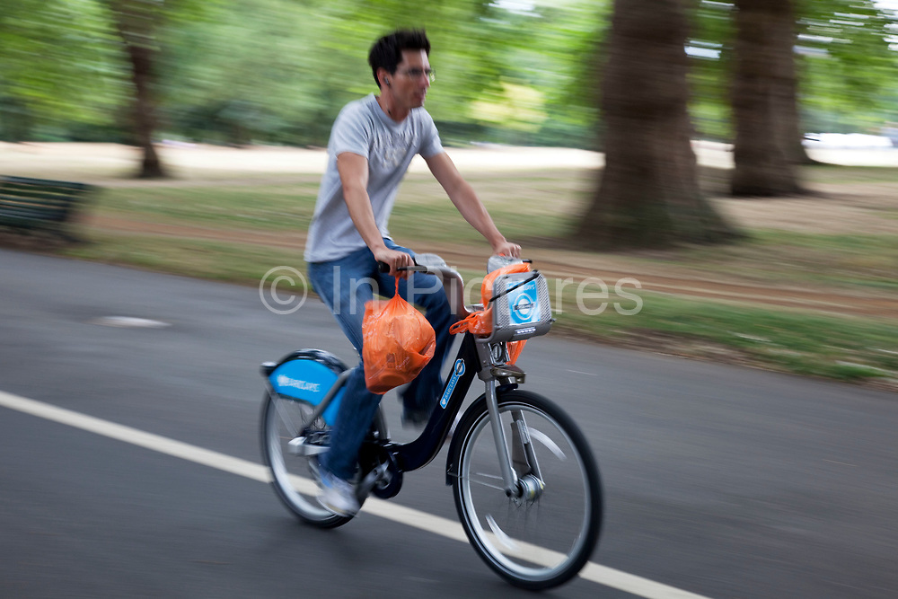 London Cycle Hire bicycles being used by people in Hyde Park. The scheme, sponsored by Barclays is intended to get Londoners cycling. As part of a major initiative. These free (for the first half hour) bikes are then charged for how long you use them. Take a cycle, ride it where you like, then return it, ready for the next person. Available 24 hours a day, all year round. It's self-service and there's no booking. Just turn up and go.