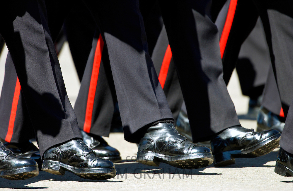 Soldiers marching during the Passing Out Parade at Sandhurst Royal Military Academy, Surrey.