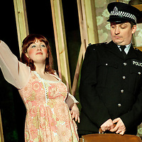 """Picture shows : Sally Reid (l) as Marie who plays the Landlord's daughter and Johnny McKnight who plays the Director Callum...Rehearsal of the forthcoming National Theatre of Scotland production 'An Appointment with The Wicker Man'..Picture © Drew Farrell  ( Tel : 07721-735041 ).On a remote Scottish island, the Loch Parry Theatre Players mount their am-dram version of The Wicker Man. When their lead actor goes missing in mysterious circumstances, they call on the services of a television cop from the mainland to step in and save their production. ..The play opens at the MacRobert Arts Centre, Stirling on 18th February 2012 before touring Aberdeen, Glasgow, Inverness and Dunfermline...The Wicker Man regularly tops """"Best Horror Film of All Time"""" lists and is regarded as a true film classic. With an unforgettable sense of creeping dread, a wonderfully memorable score by Paul Giovanni, career defining performances from Edward Woodward and Christopher Lee it also has arguably the best ending in cinema history. Now, in an affectionate new adaptation, the National Theatre of Scotland gives a gallus round of applause to this immortal chronicle of strange goings-on in a wee village. ..An Appointment with the Wicker Man features Greg Hemphill (Chewin' the Fat) and Johnny McKnight (Little Johnny's Big Gay Wedding) alongside a line-up of comic talent. It is at once a deliciously wicked homage to, and a tender celebration of, a piece of cinema history that reveals for us the spooky undercurrents lurking just below the surface of Scottish village life. ..The Loch Parry Players are messing with forces they can't possibly comprehend but at the end of the night, only one thing is for sure . . . someone's going to burn for this...Cast..Sean Biggerstaff    as       Howie and Rory.Jimmy Chisolm      as       Simon.Greg Hemphill        as     Finlay.Johnny McKnight   as      Callum.Sally Reid                 as      Marie.Paul Riley.         as      Fran.Ros Sydney"""