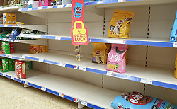 © Licensed to London News Pictures. 31/07/2021. London, UK. Nearly-empty shelves of pet food in Sainsbury's, north London. Record breaking numbers of people have been forced to self-isolate after being alerted by the NHS Covid-19 app. The pingdemic has seen staff shortages at supermarkets, resulting in less stock making its way to supermarket shelves. Labour leader Sir Keir Starmer has demanded that the government brings forward the end to self-isolation from 16 August to 7 August. Photo credit: Dinendra Haria/LNP