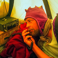 Mike Sharp talks on short wave radio from a tent in Queen Maud Land, Antarctica