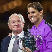 2019 US Open Tennis Tournament- Day Fourteen.   Rafael Nadal of Spain with the winners trophy presented by tennis legend Rod Laver after his victory against Danill Medvedev of Russia in the Men's Singles Final on Arthur Ashe Stadium during the 2019 US Open Tennis Tournament at the USTA Billie Jean King National Tennis Center on September 8th, 2019 in Flushing, Queens, New York City.  (Photo by Tim Clayton/Corbis via Getty Images)