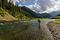 A fly angler makes a cast on the Madison River above Quake Lake in Montana
