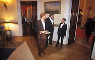 BUTLERS RUSH FROM ONE END OF THE WHITE HOUSE TO THE OTHER THROUGH THE RED ROOM WITH DISHES FOR THE PRESIDENT AND HIS GUESTS IN THE EAST ROOM FOR THE STATE DINNER.