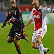 NLD/Amsterdam/20100928 - Champions Leaguewedstrijd Ajax - AC Milan, Demy de Zeeuw in duel met Robinho