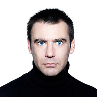 caucasian man portrait expressing mistrust distrust frowning portrait on studio isolated white background