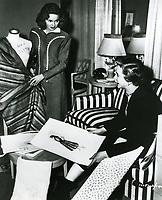 """1948 Actress Ann Blyth & Costume Designer Mary Kay Dodson review sketches at Paramount Studios for their next movie project """"Whispering Smith"""""""