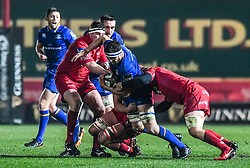Leinster's Josh Murphy is tackled by Scarlets' Will Boyde<br /> <br /> Photographer Craig Thomas/Replay Images<br /> <br /> Guinness PRO14 Round 17 - Scarlets v Leinster - Friday 9th March 2018 - Parc Y Scarlets - Llanelli<br /> <br /> World Copyright © Replay Images . All rights reserved. info@replayimages.co.uk - http://replayimages.co.uk