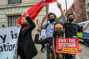 People show the three-finger salute on Wednesday, March 31, 2021 - in central London, Britain, as they rally in a protest against the military coup and to demand the release of elected leader Aung San Suu Kyi, in Yangon, Myanmar. (Photo/ Vudi Xhymshiti)
