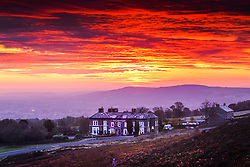 © Licensed to London News Pictures. 19/10/2020. Ilkley UK. The sky glows red at Dawn this morning over the Cow & Calf pub on Ilkley moor in Yorkshire as the UK expects heavy rain & gales this week. Photo credit: Andrew McCaren/LNP