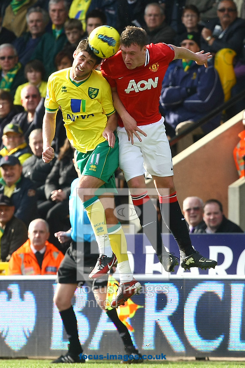 Picture by Paul Chesterton/Focus Images Ltd.  07904 640267.26/02/12.Andrew Surman of Norwich wins a header during the Barclays Premier League match at Carrow Road Stadium, Norwich.
