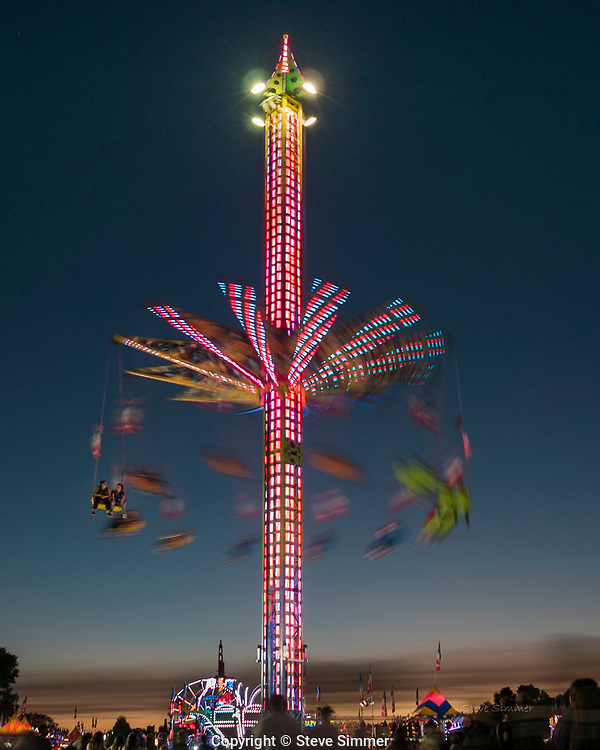 The blue hour is the last stop before dark. It is a great time for taking pictures like this. Minnesota State Fair.