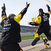 The pit crew of Camping World Truck Series driver Matt Crafton (88) lept in the air after Crafton won the NASCAR Camping World Truck Series 13th Annual SPF 250 on Saturday, April 20, 2013 at Kansas Speedway in Kansas City, Kan.