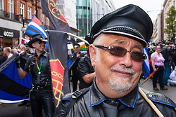 London, June 28th 2014. A leather clad man marches as the Pride London parade proceeds through the city's streets.