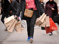 """File photo dated 06/12/11 of a lady carrying shopping bags. Retail sales were flat in May after a strong April as financially pressed households led to """"tepid"""" trading conditions, figures show."""