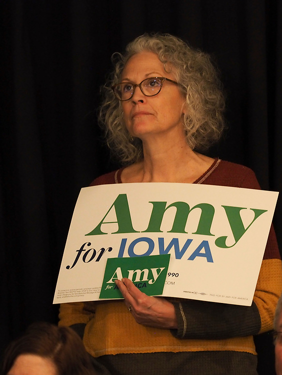 An Amy Klobuchar supporter listens attentively during her Cedar Rapids Get Out the Caucus rally.