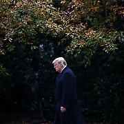 President Trump walks out to the South Lawn where Marine One will before flying to campaign rallies for Sen. Cindy Hyde-Smith (R-Miss.) on Monday, November 26, 2018.