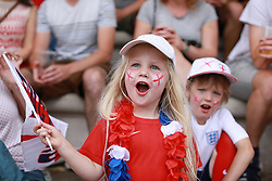 © Licensed to London News Pictures . 11/07/2018. Manchester, UK. EMILY COOK (five) and ALEX COOK (seven) from Didsbury. Football fans gather to watch England play against Croatia in the World Cup semi finals, on a big screen at Castlefield Bowl in Manchester City Centre . Until today , Manchester had been the largest city in England not to be showing World Cup matches to the public on a big screen . Photo credit: Joel Goodman/LNP