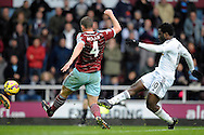 Wilfried Bony of Swansea city takes a shot at goal. Barclays Premier league match, West Ham Utd v Swansea city at the Boleyn ground, Upton Park in London on Sunday 7th December 2014.<br /> pic by John Patrick Fletcher, Andrew Orchard sports photography.