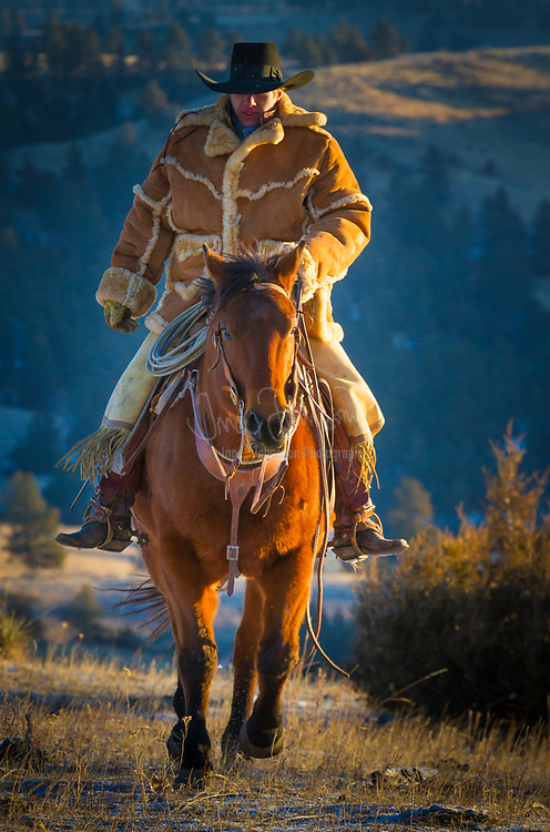 Cowboy riding a horse on ranch in northeastern Wyoming