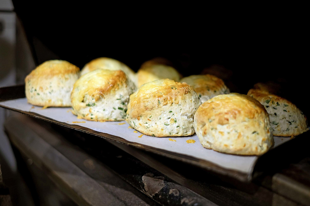 Freshly baked cheese and spinach scones at the Haxby Bakehouse, Yorks artisan bakery in Haxby, North Yorkshire, United Kingdom on 17th February 2017. Haxby Bakehouse make bread using traditional methods of slow fermentation. They use low yeasted overnight sponges, natural sourdough levain or a combination of the two. This means the bread they produce is full of flavour without the use of any artificial flour improvers, preservatives or emulsifiers.