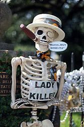 30 October 2015. New Orleans, Louisiana.<br /> The Skeleton Krewe mansion on St Charles Avenue at the corner of State Street draws crowds with its satirically spooky Halloween decorations. Lady killer.<br /> Photo©; Charlie Varley/varleypix.com