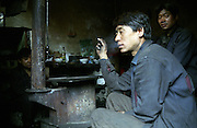 Large groups of coal miners live in the proximity of the mines.  They live together in a small space sharing all the amenities. Yushe Coal Mine, illegal coal mine on the Laoying Mountain.