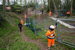 Wendover, UK. 28th April, 2021. Security guards working on behalf of HS2 Ltd stand in front of fencing on a privately owned area of ancient woodland at Jones Hill Wood in the Chilterns AONB. Felling of the section of woodland now owned by HS2 Ltd, which contains resting places and/or breeding sites for pipistrelle, barbastelle, noctule, brown long-eared and natterer's bats, has recommenced after a High Court judge yesterday refused campaigner Mark Keir permission to apply for judicial review and lifted an injunction on felling.