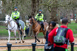 © Licensed to London News Pictures. 21/01/2021. London, UK. Mounted police patrol Hyde Park today. Police continue to patrol parks across the capital while members of the public wrapped up against the wind and enjoy a walk during lockdown. Today, Prime Minister Boris Johnson warned that it was too early to know if Covid-19 restrictions would be lifted in spring or even summers as infections continue to spread throughout out the capital and the rest of the UK. Photo credit: Alex Lentati/LNP