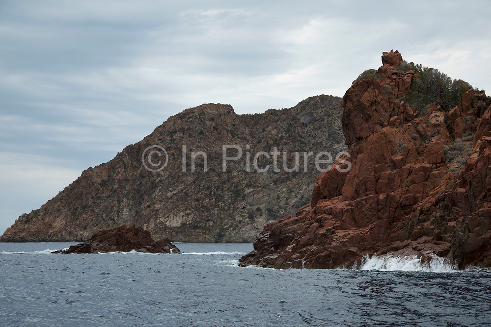 Volcanic coastal landscape of the Scandola Nature Reserve on 15th September 2017 in Corsica, France. The Scandola Nature Reserve is located on the west coast of the Corsica, within the Corsica Regional Park. The reserve was established in 1975 and has been recognized by the United Nations as a Natural World Heritage Site, and was inscribed on the World Heritage List in 1983.