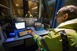 @Licensed to London News Pictures 29/11/2014. Dartford Crossing, South Orbital Road, Dartford, Kent. Booth operator Mark Martin gets ready to take the last cash transaction at the Dartford Crossing. Payment booths at the Dartford Crossing will be removed and replaced with a remote charging system known as Dart Charge. Photo credit: Manu Palomeque/LNP