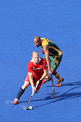 Ben Haswe of Great Britain evades the tackle of Julian Hykes of South Africa during the men's hockey match between South Africa and Great Britain held at the Riverbank Arena at Olympic Park in London as part of the London 2012 Olympics on the 1st August 2012..Photo by Ron Gaunt/SPORTZPICS