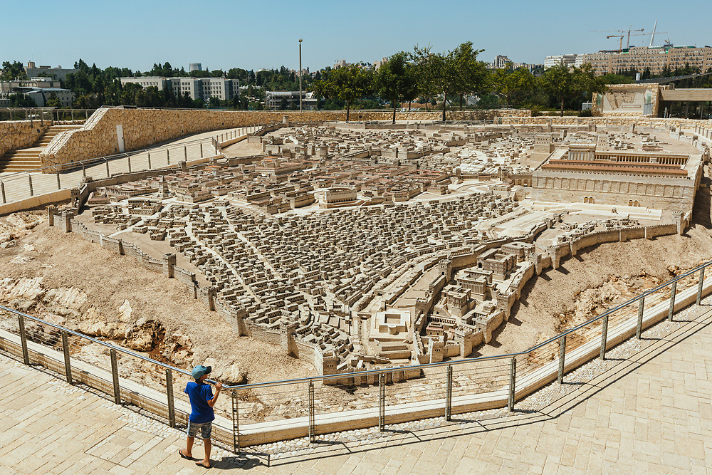 A child looks at a model of the Second Temple, at the Israel Museum in Jerusalem