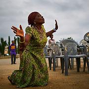 A woman in prayer. Koforidua, Ghana