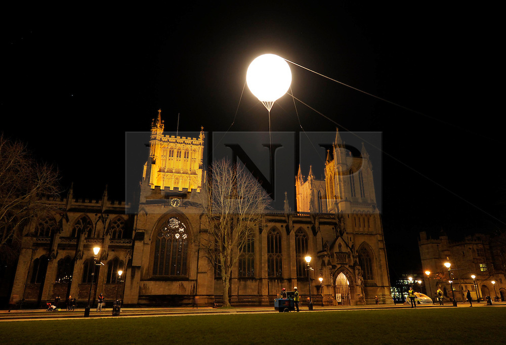 """© Licensed to London News Pictures. 14/02/2013. Bristol, UK. IBT13 International Festival of Performance.  Picture of """"Fake Moon"""" by Simon Faithfull, on Bristol's College Green by Bristol Cathedral.  14 February 2013..Photo credit : Simon Chapman/LNP"""