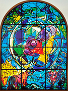 The Tribe of Benjamin. The Twelve Tribes of Israel depicted in stained glass By Marc Chagall (1887 - 1985). The Twelve Tribes are Reuben, Simeon, Levi, Judah, Issachar, Zebulun, Dan, Gad, Naphtali, Asher, Joseph, and Benjamin.
