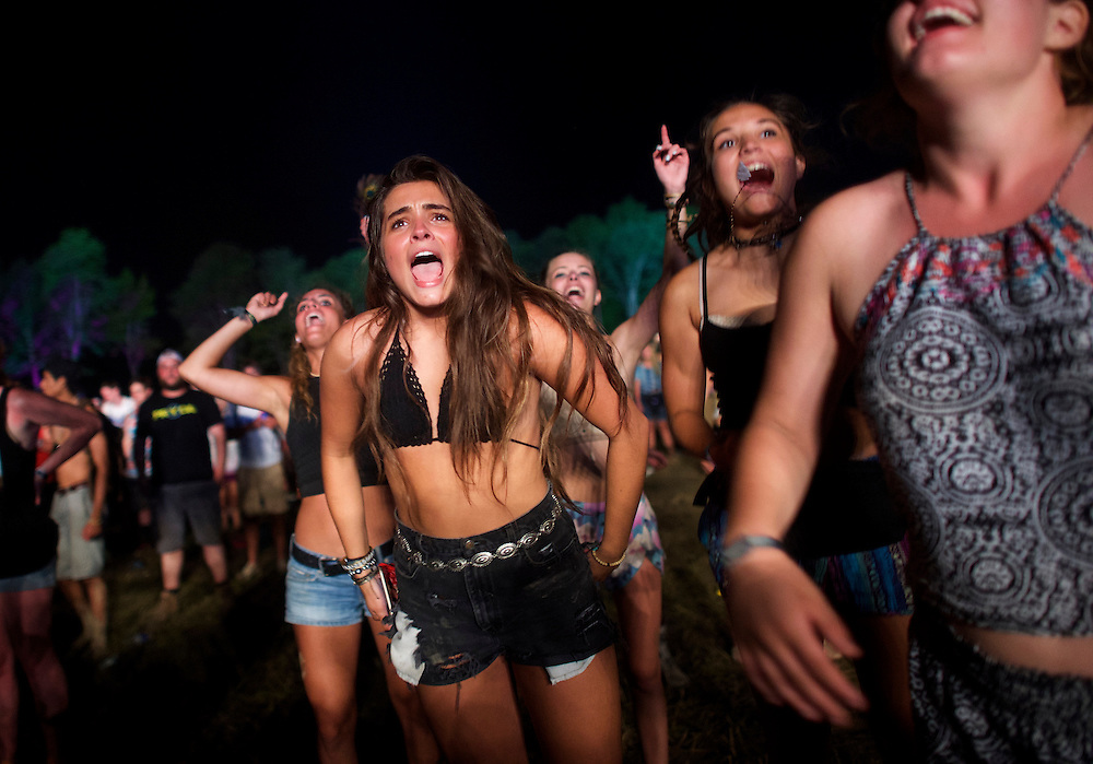 (L-R) Marielle Wanner, 17, Kath Suchanec, 18, and Adele Trefry, 17, dance during the performance by Sir Paul McCartney at the Firefly Music Festival in Dover, Delaware June 19, 2015.  According to organizers, attendance exceeded 90,000 for the four day festival, which featured more than 110 acts, and was set in 105 acre grounds of the Dover International Speedway.