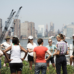 Annie Novak meeting with volunteering farmers before farming. Eagle Street Rooftop Farm in Greenpoint, Brooklyn (NY).  20 June 2010. Photo: Antoine Doyen