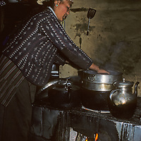 Lhakpa Doma Sherpani prepares a meal in the kitchen of her house in Namche Bazaar, the leading town of Nepal's Khumbu region.