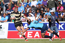 Logan Basson of Boland attempts to get past Ulrich Beyers of the Blue Bulls during the Currie Cup premier division match between the Boland Cavaliers and The Blue Bulls held at Boland Stadium, Wellington, South Africa on the 23rd September 2016<br /> <br /> Photo by:   Shaun Roy/ Real Time Images