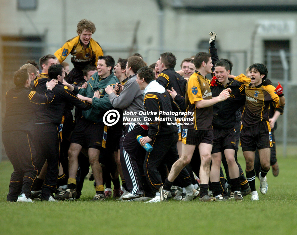 """10-03-07. St. Patrick's Classical School, Navan v Knockbeg College, Carlow - Leinster Colleges SFC """"A"""" final at Tullamore.<br /> St. Pat's players and mentors celebrating at the end.<br /> Photo: John Quirke.<br /> ©John Quirke Photography, Unit 17, Blackcastle Shopping Cte.<br /> Navan. Co. Meath. 046-9079044 / 087-2579454."""