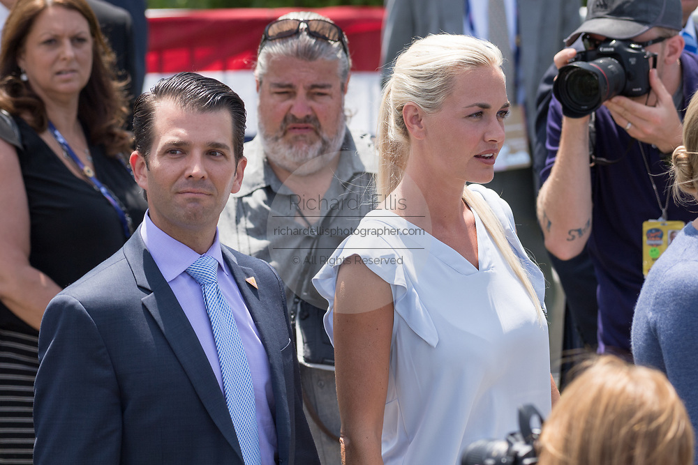 Don Trump, Jr. and his wife Vanessa Haydon wait for the arrival of his father GOP Presidential Nominee Donald Trump by helicopter to the Republican National Convention July 20, 2016 in Cleveland, Ohio. Trump flew into the Cleveland Burke Lakefront Airport by his private jet and then by helicopter for a grand arrival.