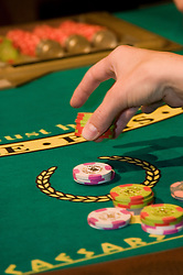 Blackjack table in Las Vegas, Nevada, Caesars Palace and Casino, gaming, gambling,  hand, chips, betting, model released, craps table, NV, Las Vegas, nvlvcity231.Copyright: Lee Foster, www.fostertravel.com, 510-549-2202,lee@fostertravel.com